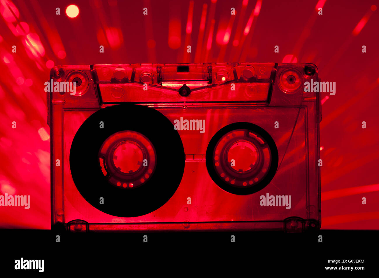 Transparent Cassette tape disco lights background - Stock Image