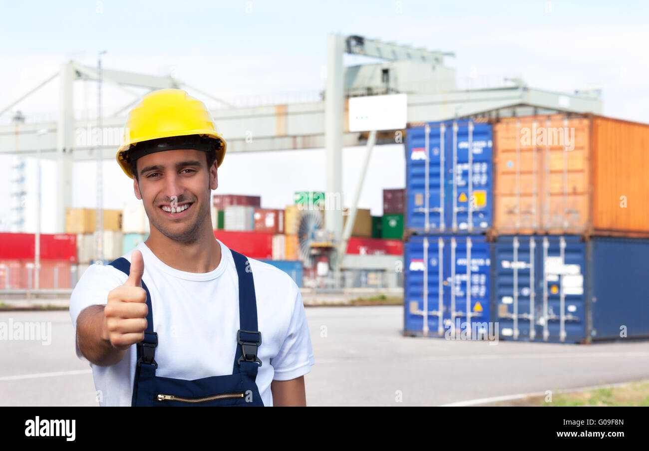 Docker on a seaport showing thumb up - Stock Image