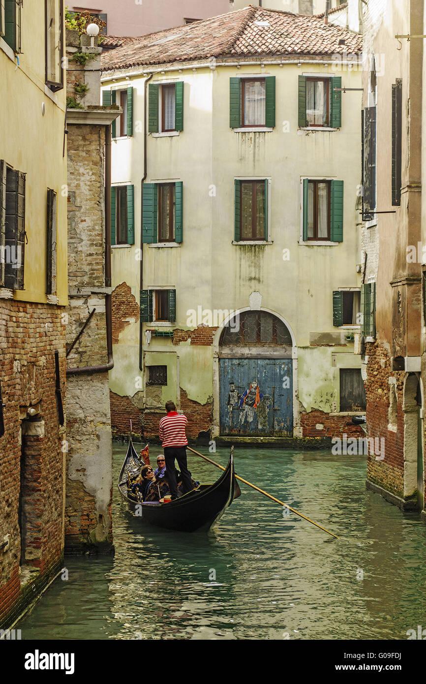 Gondola Moving Through The backstreets venice Ital - Stock Image