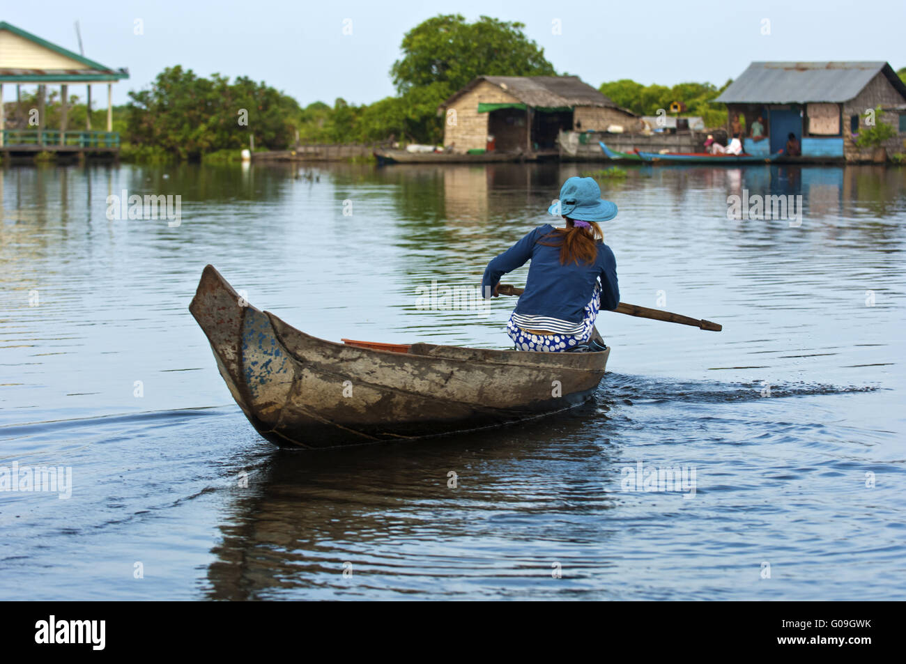 Woman paddling in a boat on the Tonle Sap lake Stock Photo