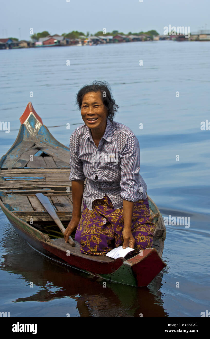 postman with a letter in a boat on Tonle Sap lake Stock Photo