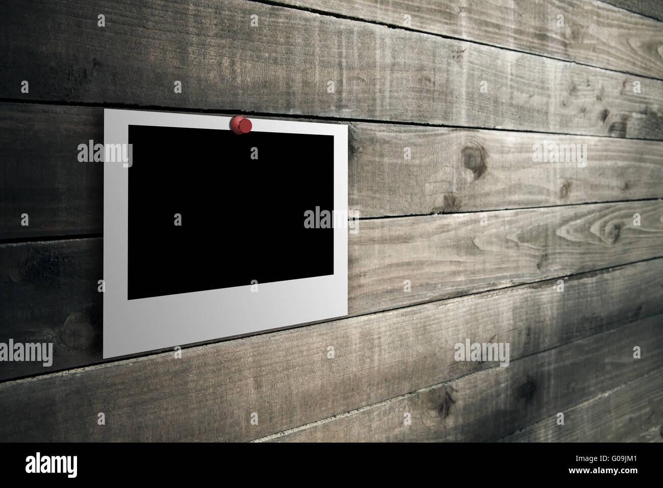 Polaroid on the wooden floor - Stock Image