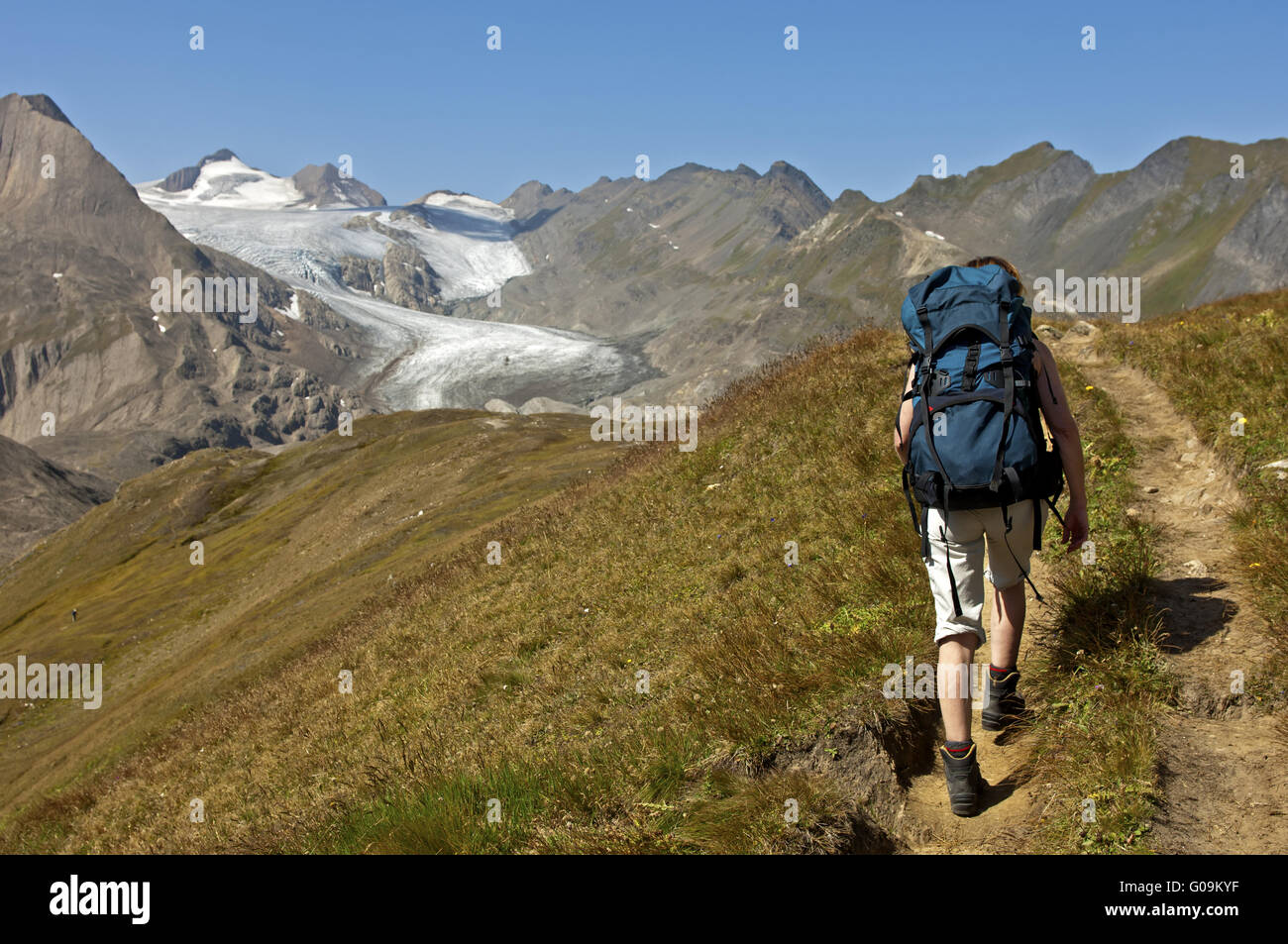 Hiker on a hiking tour, Valais, Switzerland - Stock Image