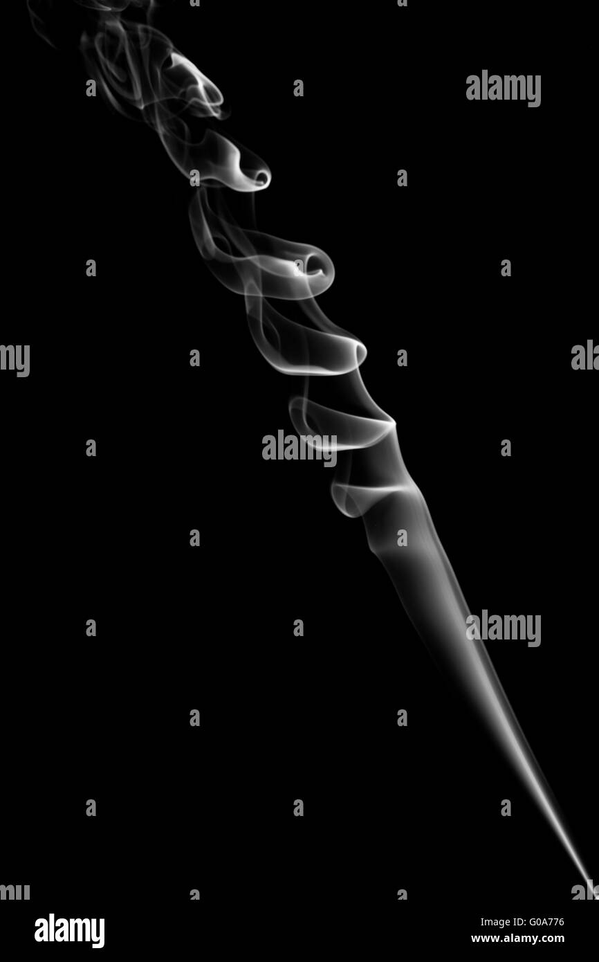 The abstract figure of the smoke on a black background - Stock Image