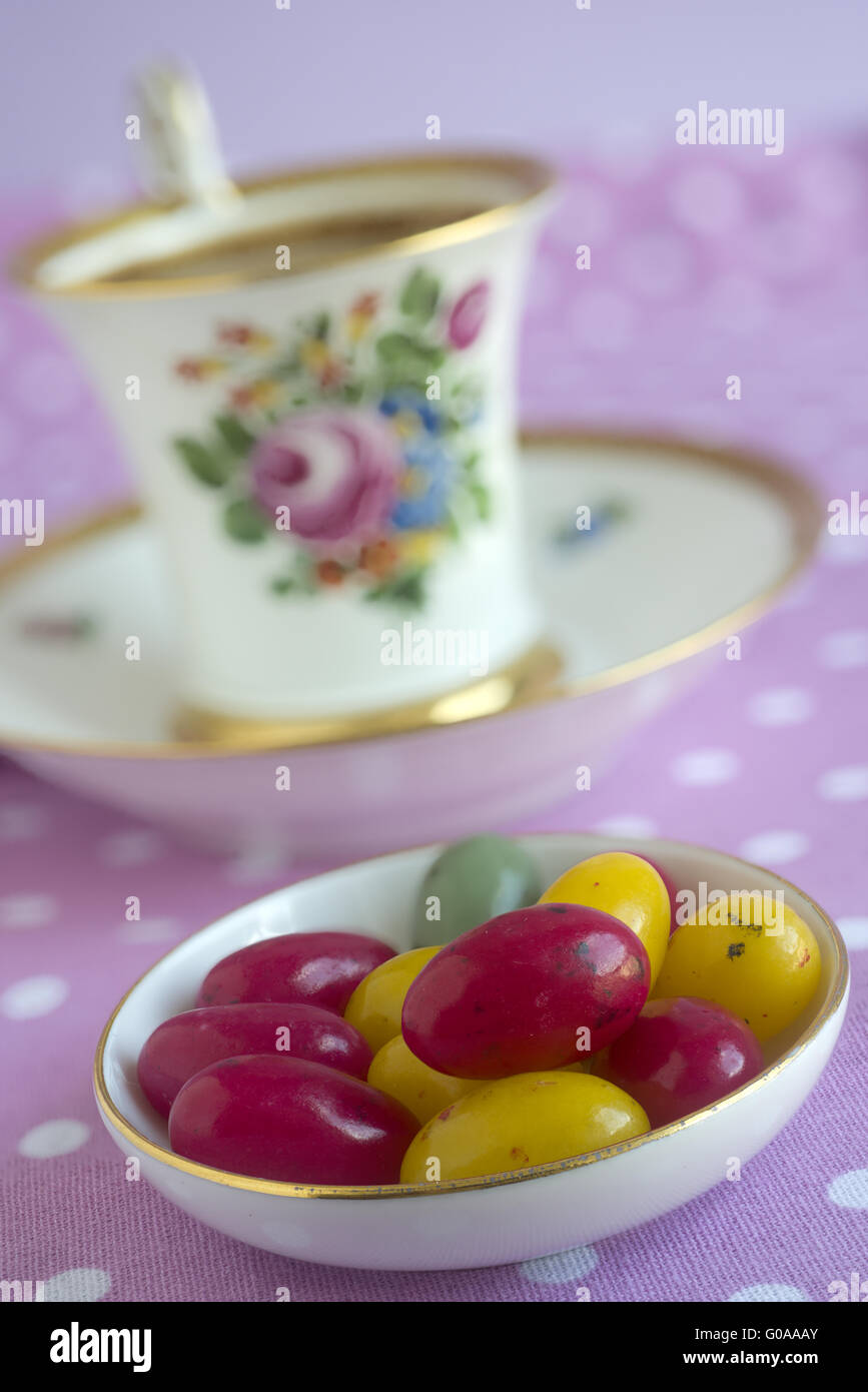 Sugar eggs and a cup of coffee (Nymphenburg china) - Stock Image
