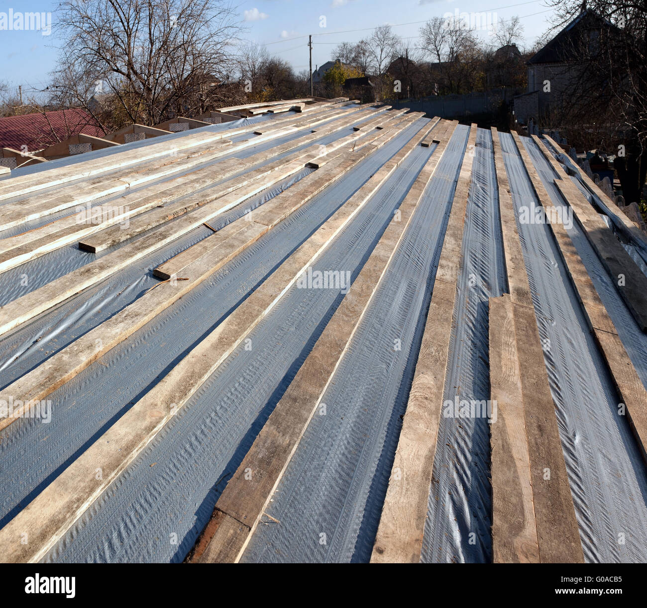 Installation of a hydraulic barrier at the roof - Stock Image