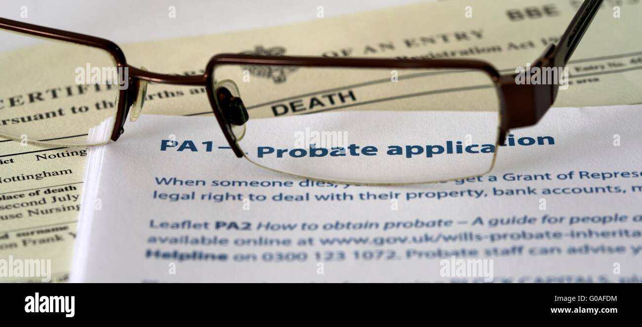 death certificate and  PA1 probate application form with a pair of spectacles. Stock Photo