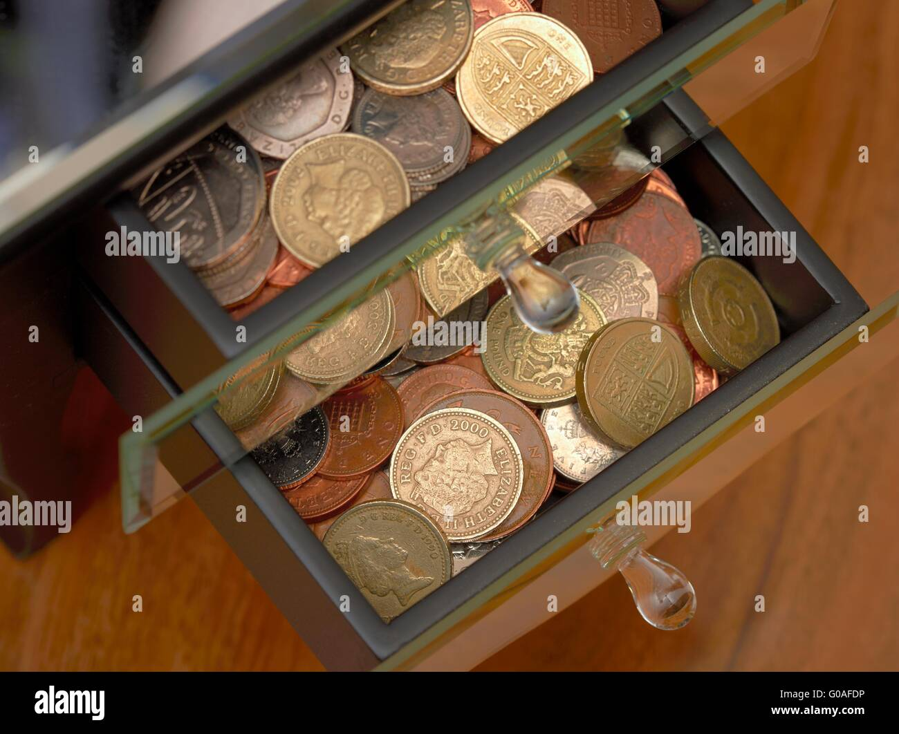 Stash of Coins kept in jewelery draws home savings concept. - Stock Image