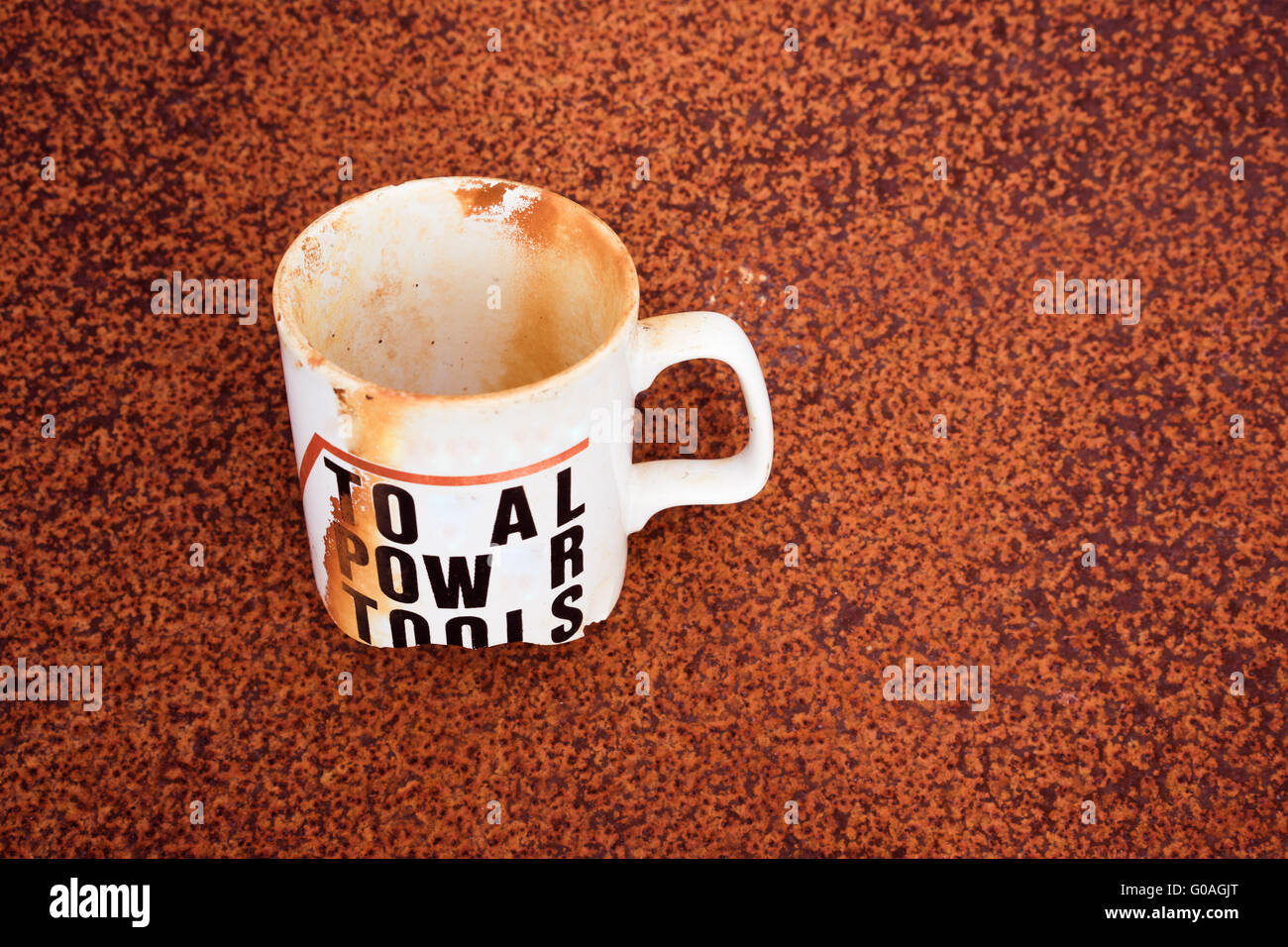 Stained Single White Cup Buried Stock Photo