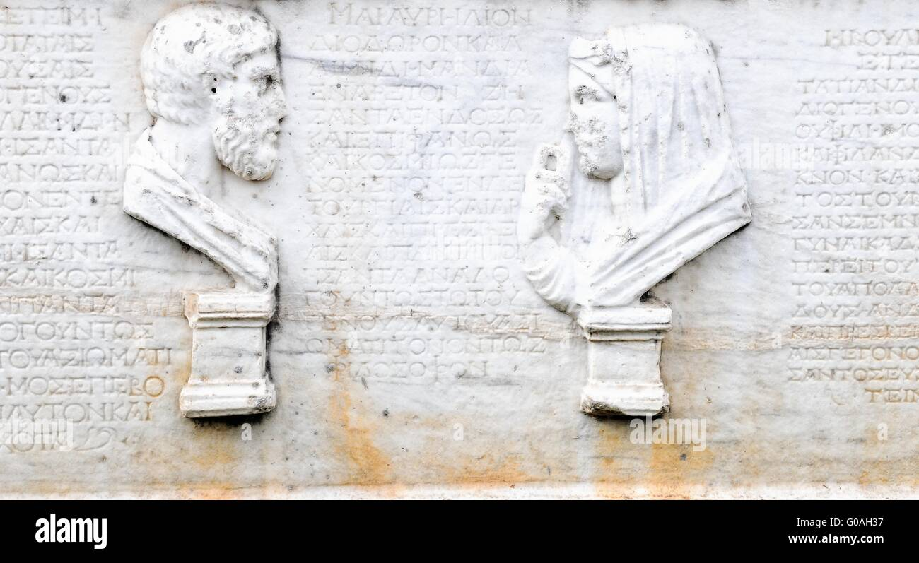 Portrait busts female - male Greek representation - Stock Image