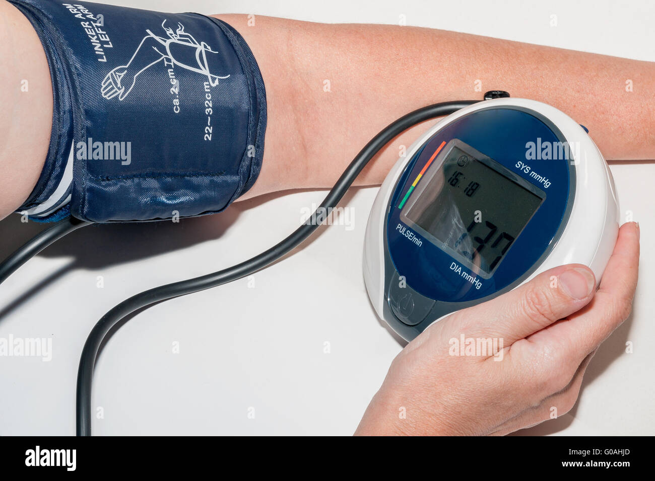 Sphygmomanometer measuring blood pressure on an ar Stock Photo