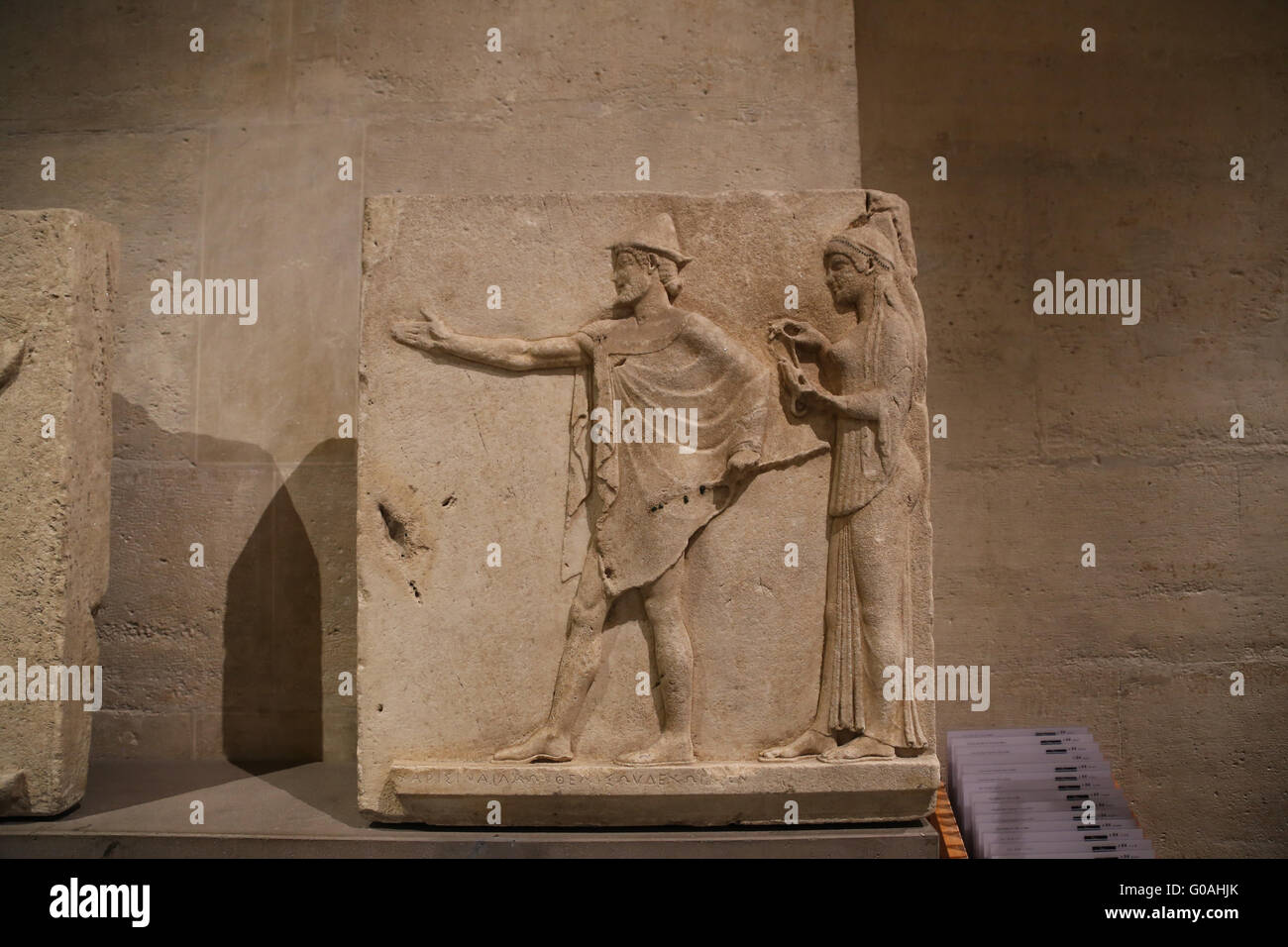 Hermes agoraios and a Charity. Relief from the Passage of the Theores, Thasos, c.470 BC . Marble. - Stock Image