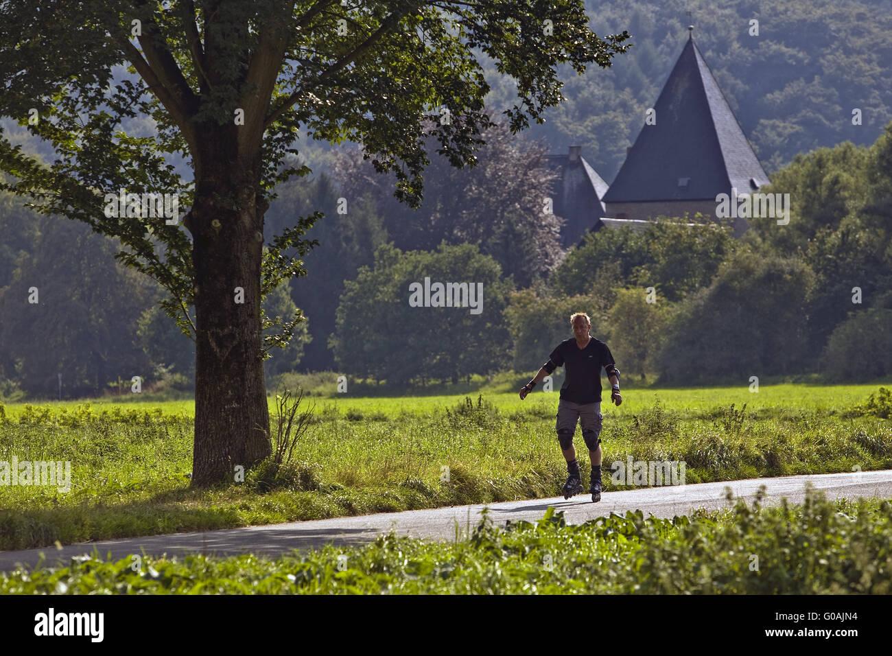 Skater with castle Kemnade, Hattingen, Germany. - Stock Image