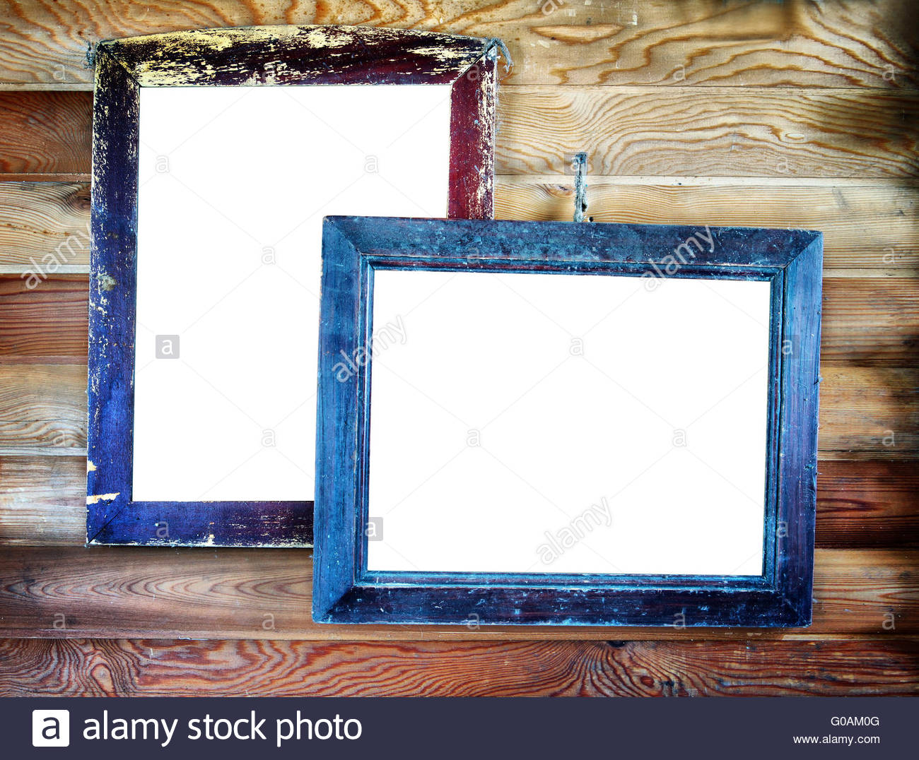 Two old vintage wooden frames with empty space for text hanging on ...