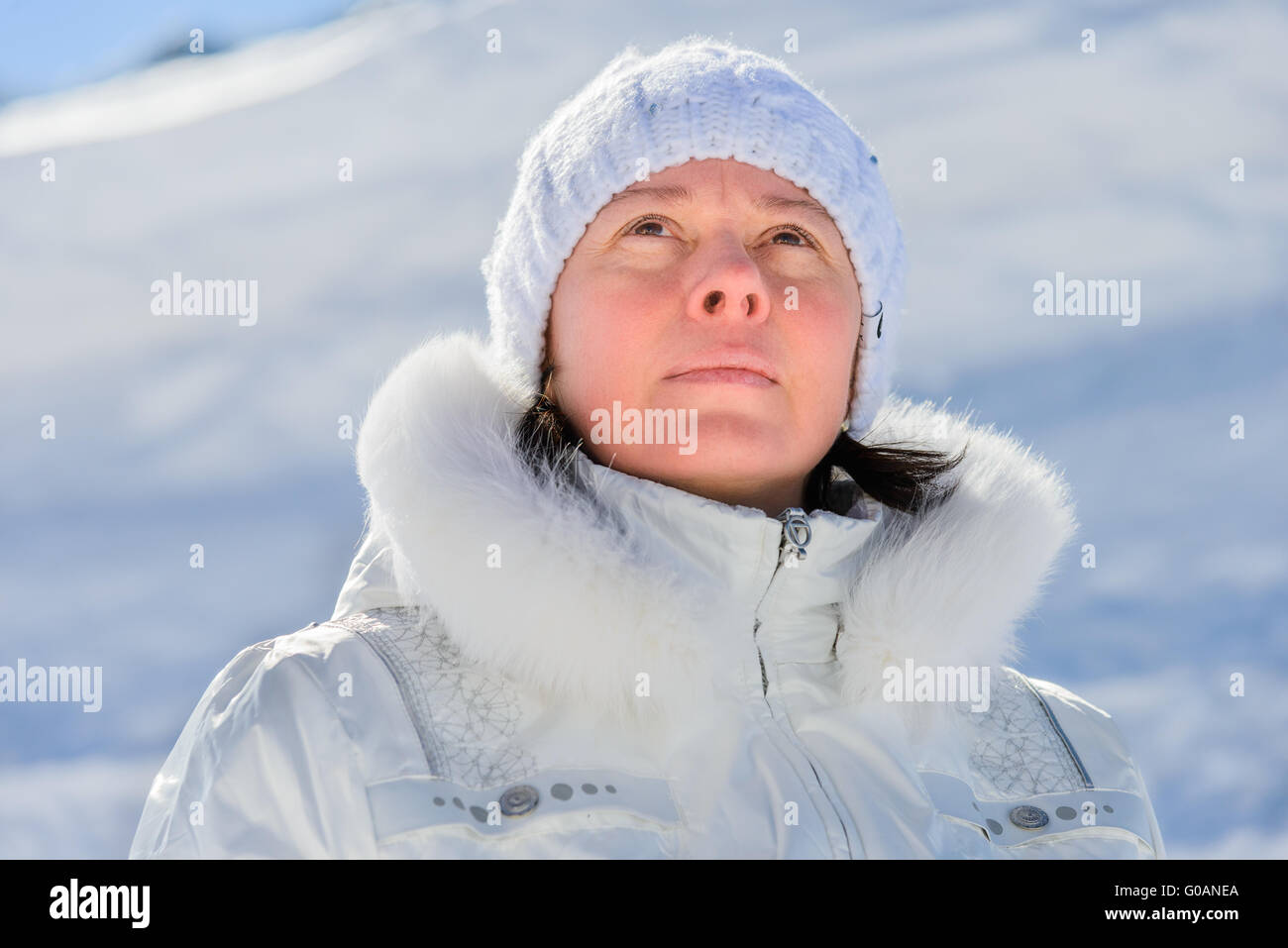 woman in ski suit on a background of mountains - Stock Image