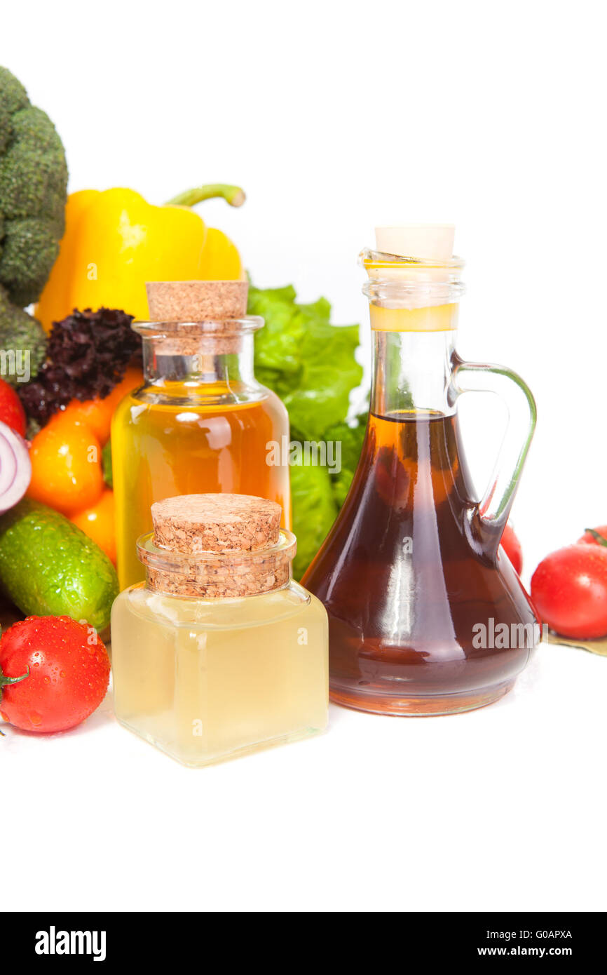 vegetables and few vessels with oil Stock Photo