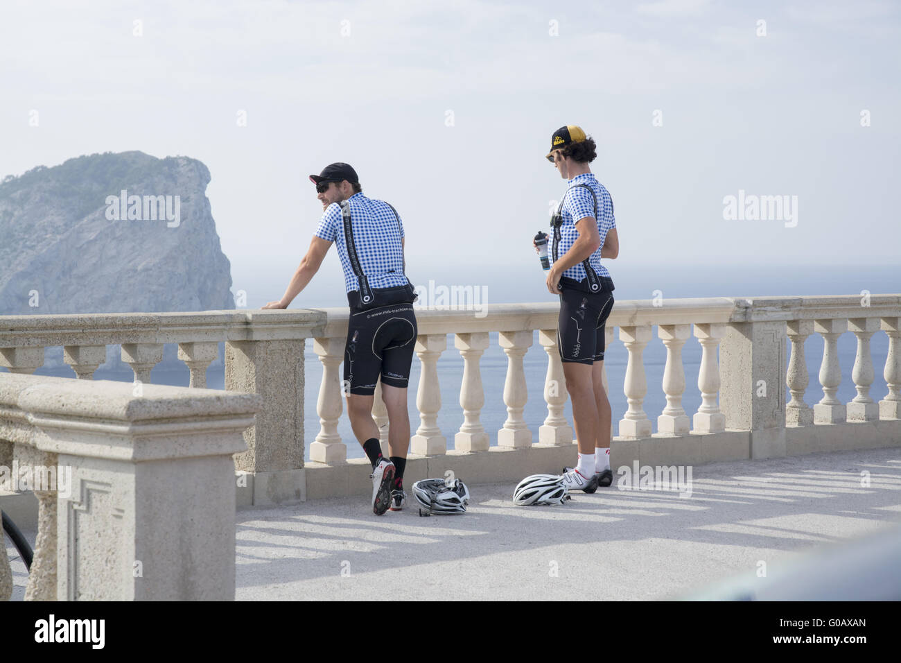 Two bicyclists admiring the view from Formentor li - Stock Image