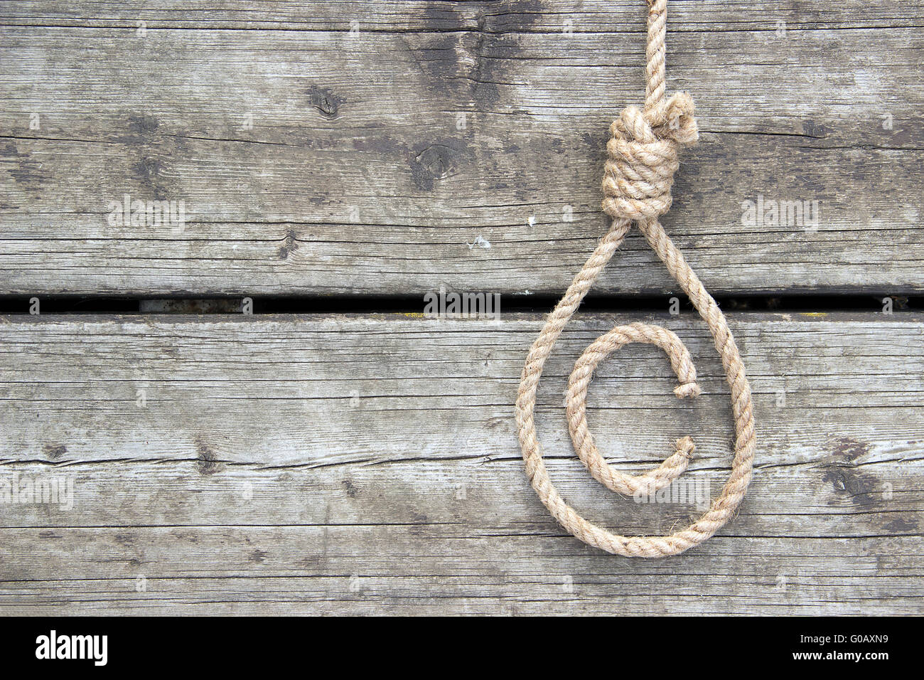 Copyright Symbol Presented As A Noose On A Wooden Surface Stock