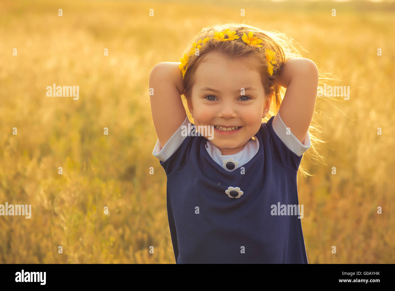 the beautiful little girl in a blue dress against Stock Photo