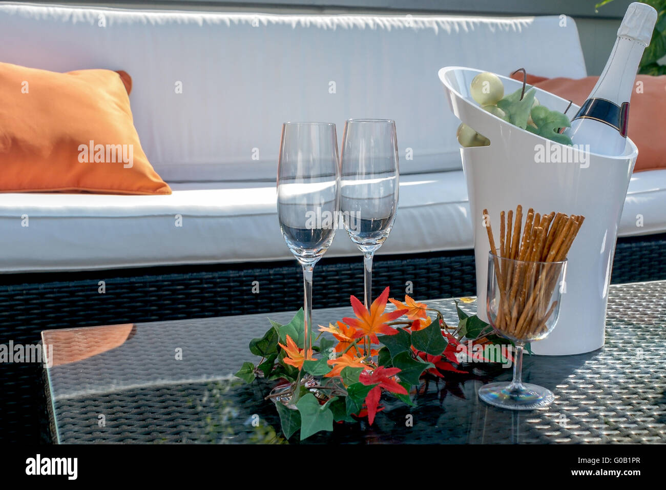 Terrace with champagne glasses and champagne bottl - Stock Image