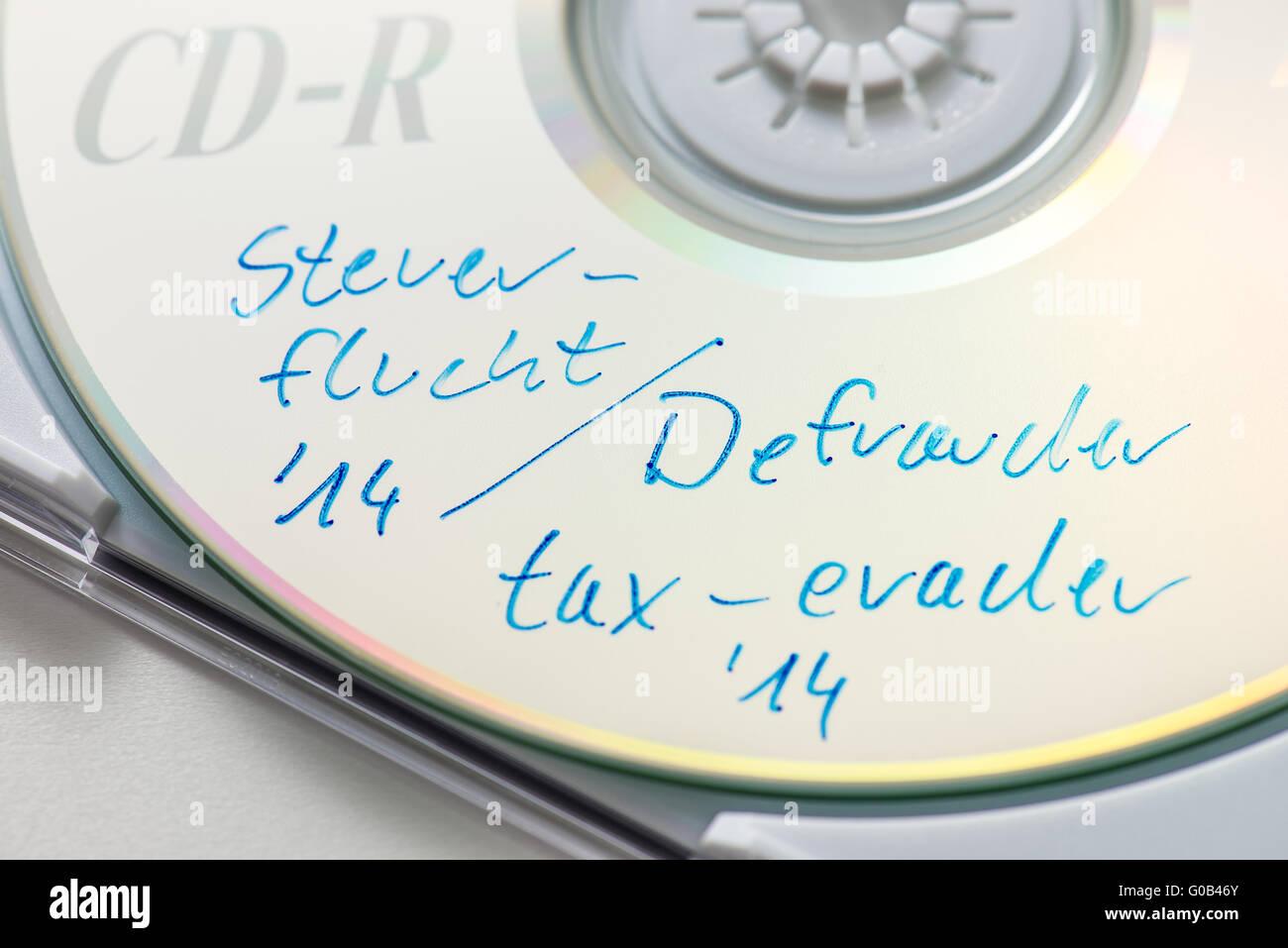 Tax evasion CD - Stock Image