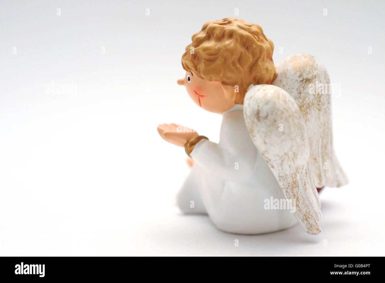 look at the back of an angel-figure, isolated - Stock Image