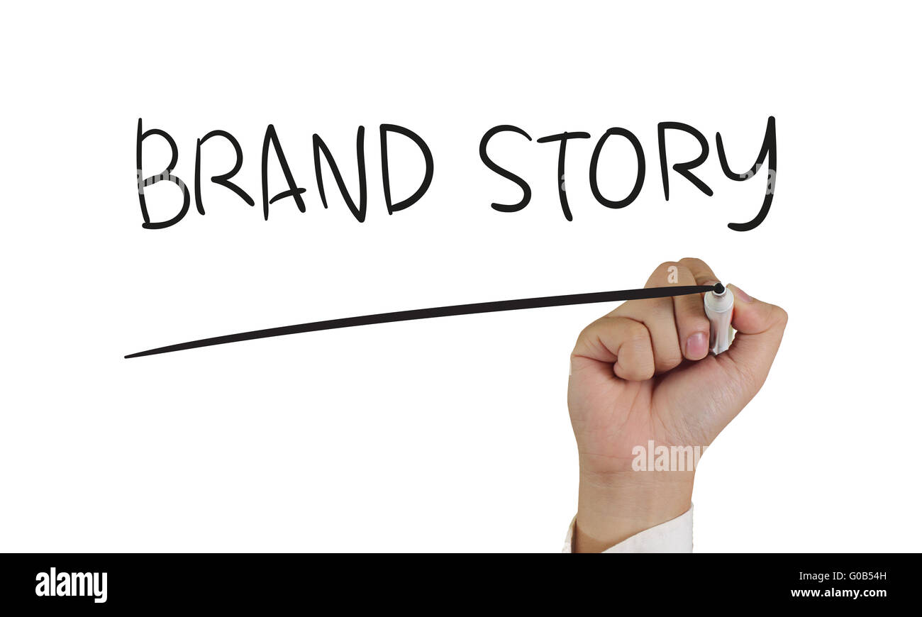 Business concept, image of a hand holding marker and write Brand Story, isolated on white - Stock Image