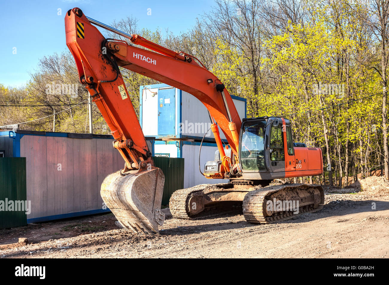 Excavator at construction site in summer sunny day Stock Photo