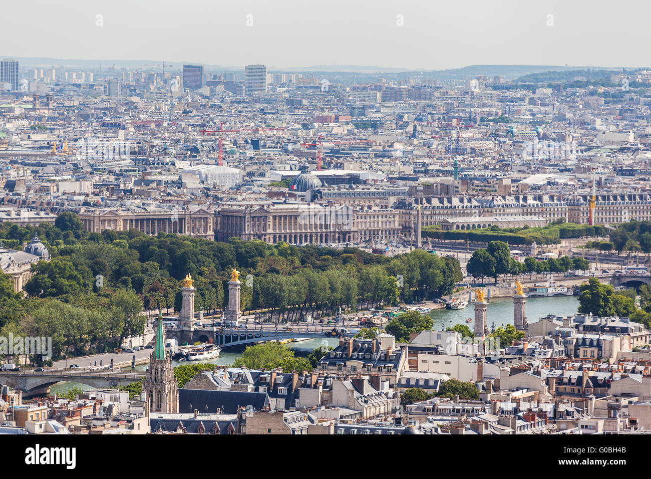 Cityscape of Paris with aerial view from Eiffel tower - the Seine river and the bridge of Pont Alexandre III in Stock Photo