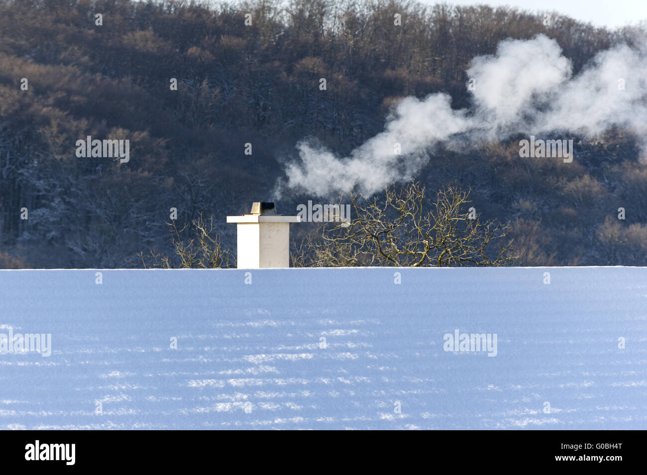 Exhaust pollution by residential houses in winter - Stock Image