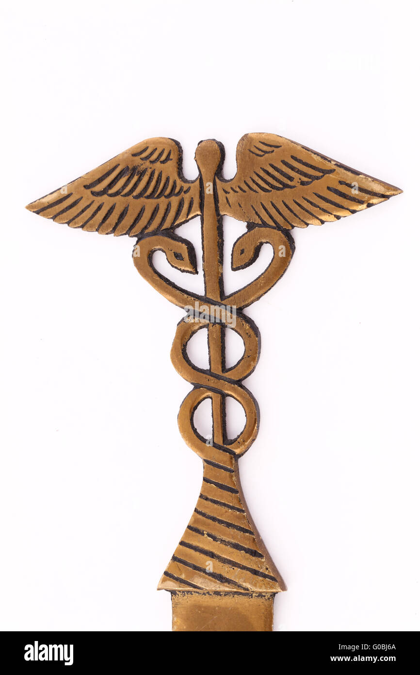 Closeup of nurses letter opener with snakes and staff Stock Photo