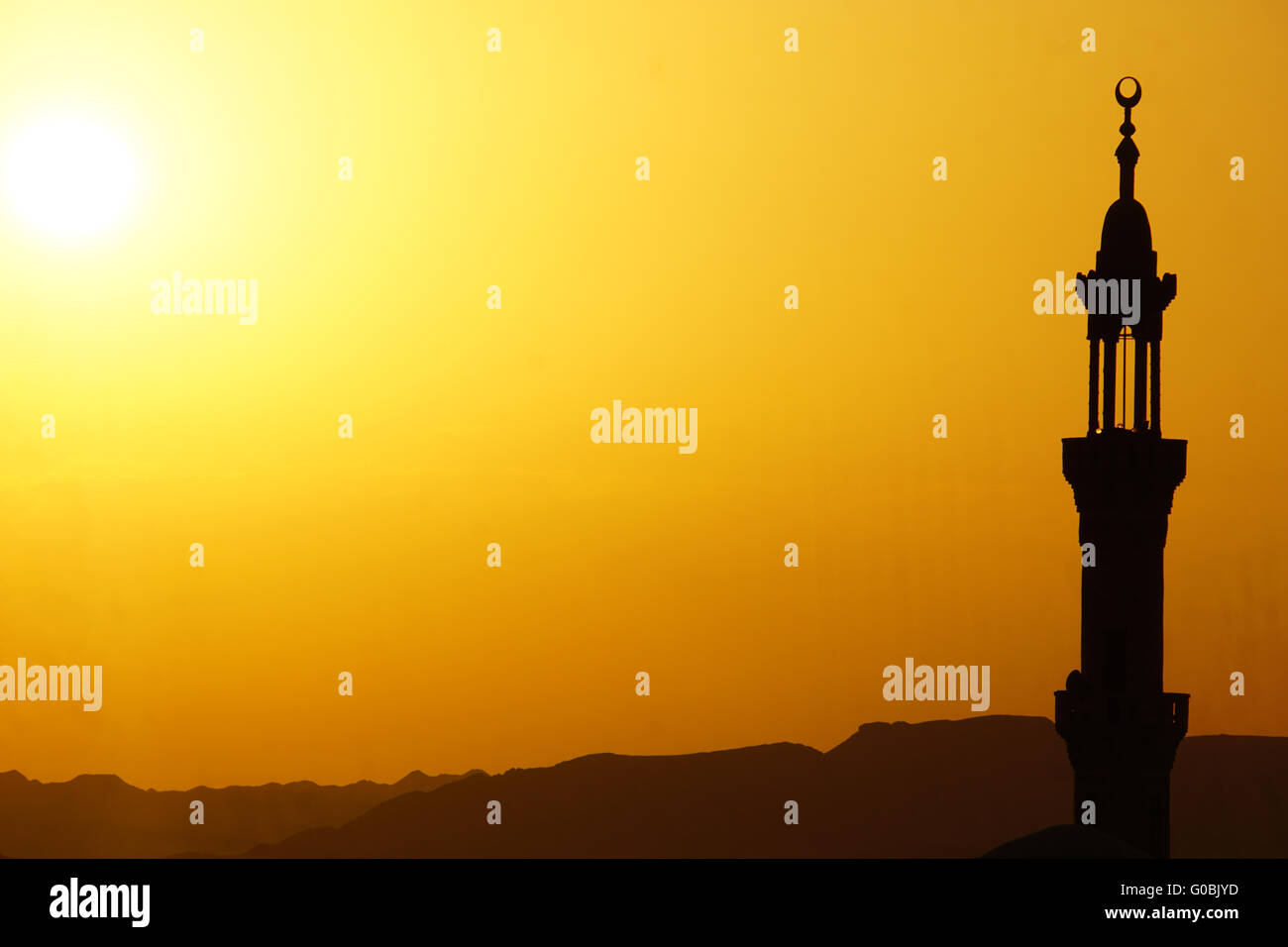 sunset over mosque in egypt town of el quesir - Stock Image