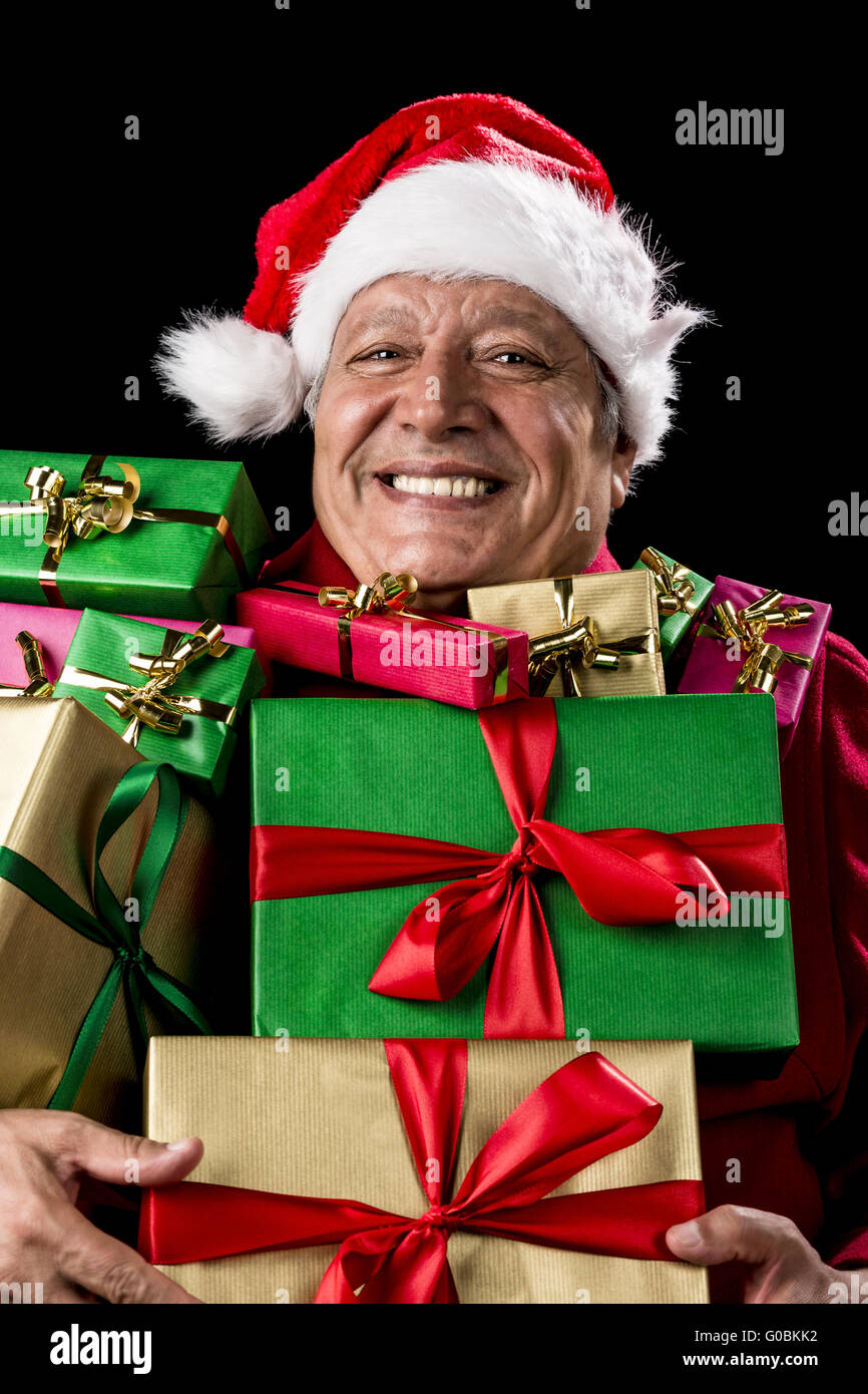 Merry Old Man With Broad Grin Loaded With Gifts - Stock Image