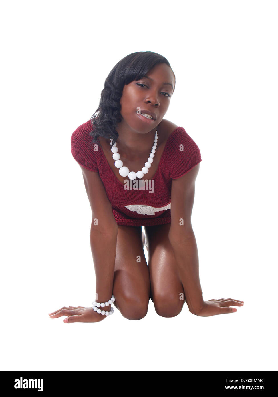 young black woman kneeling in short red dress stock photo 103519932