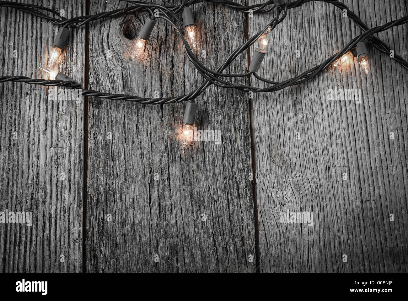 White Christmas Tree Lights With Rustic Wood Background
