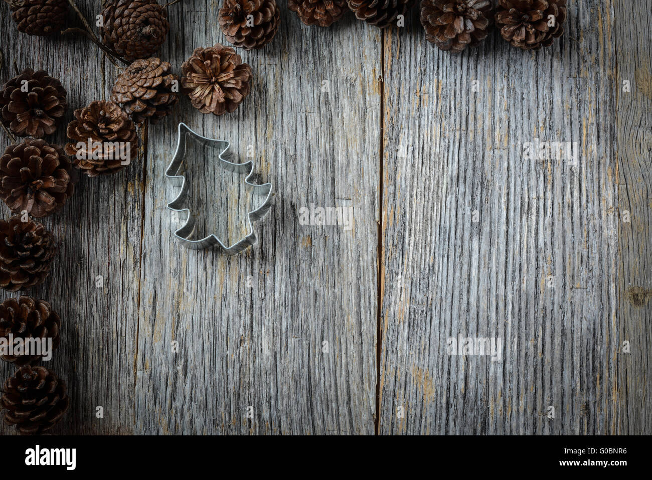 Pine Cones And Christmas Tree On A Rustic Wood Background