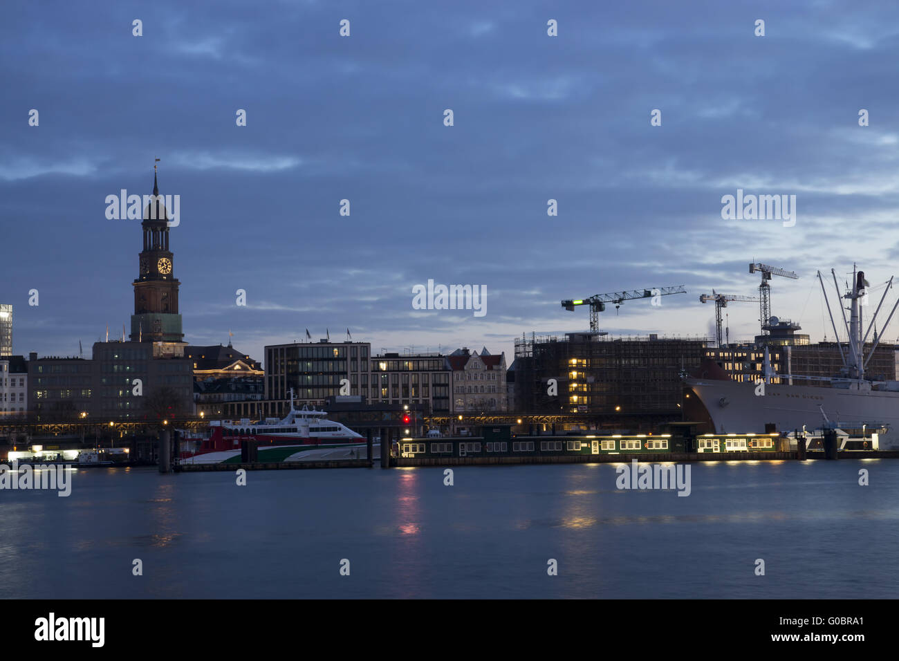 The harbor of Hamburg with St. Michaelis, Germany Stock Photo