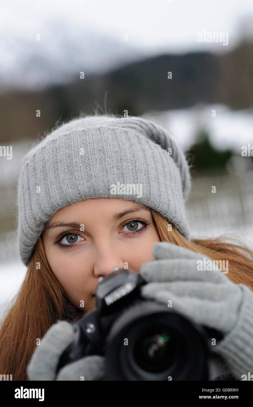 Female with digital camera - Stock Image