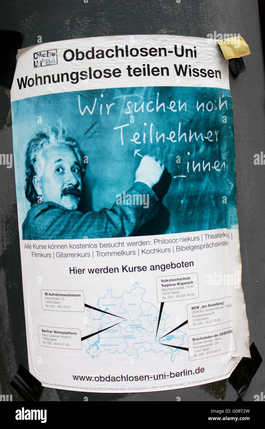 Werbung fuer Obdachlosen-Uni mit einem Bild von Albert Einstein, Berlin-Tiergarten. - Stock Image