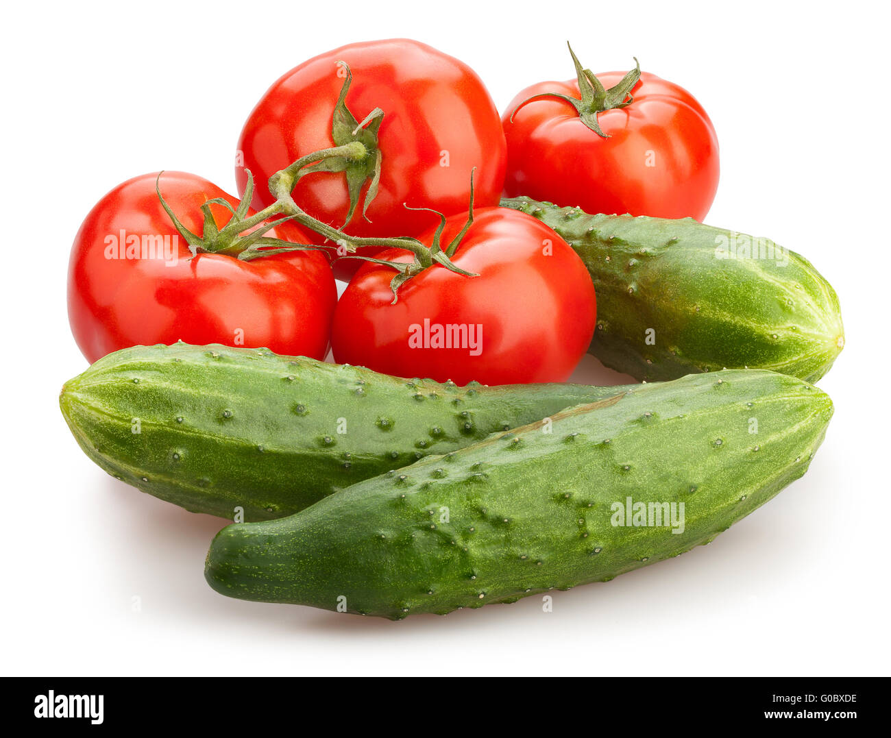 red tomatoes cucumber mix isolated - Stock Image