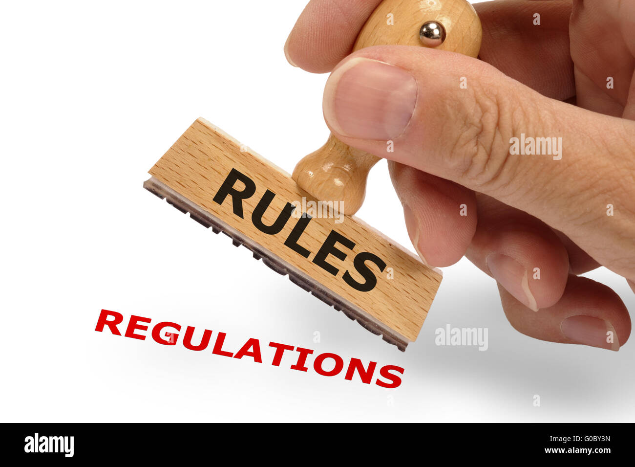 rules and regulations marked on rubber stamp Stock Photo