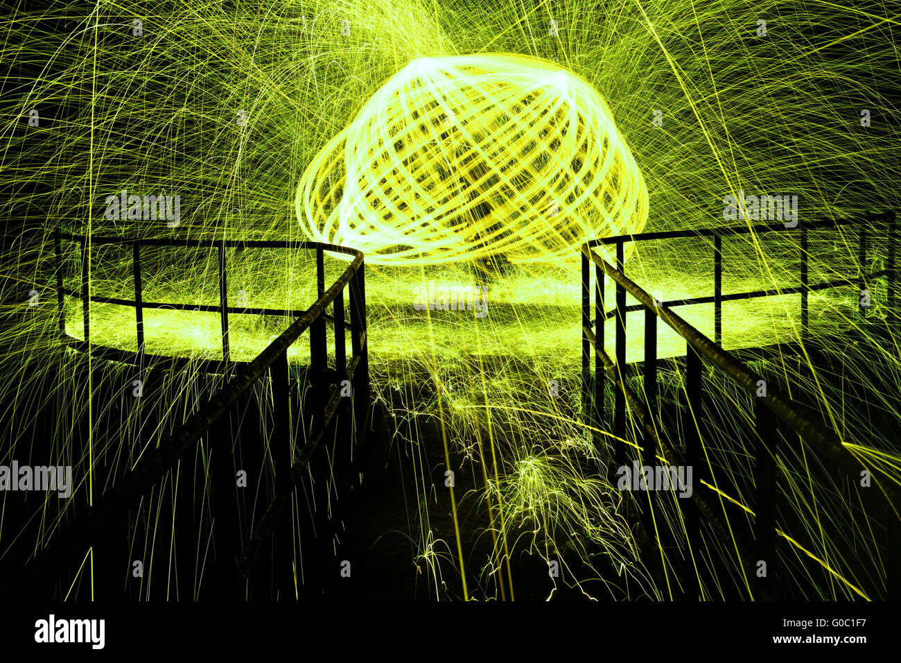 Showers of hot glowing sparks from spinning steel wool - Stock Image