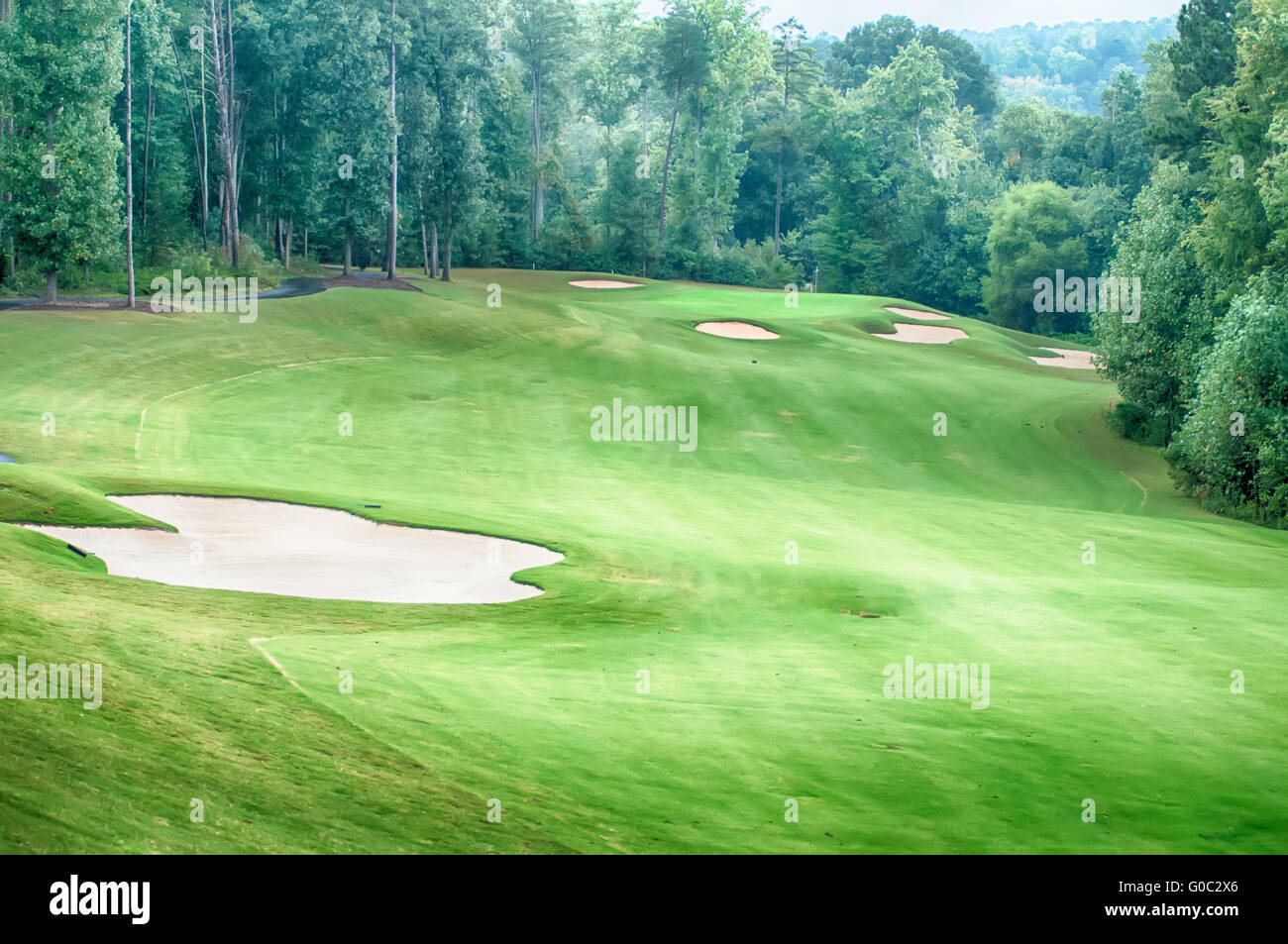 luxurious golf course on a cloudy day - Stock Image