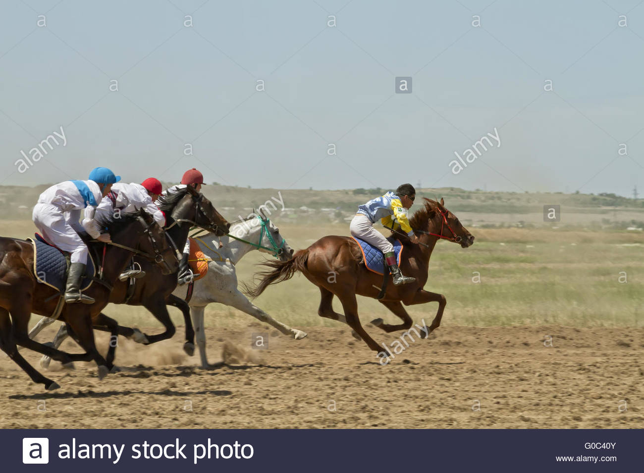 Jockey riding a horse during the horse races - Stock Image