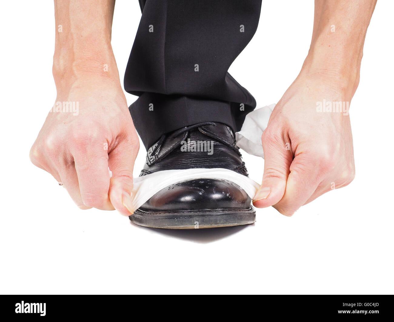 Shoe shining, black leather shoe - Stock Image