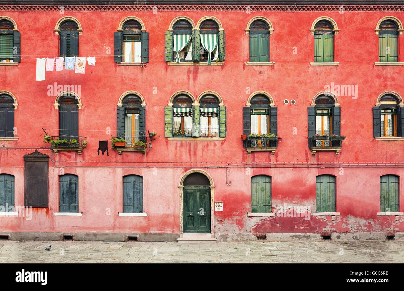 Duplex colored house on the island of Murano near Venice in Italy. - Stock Image