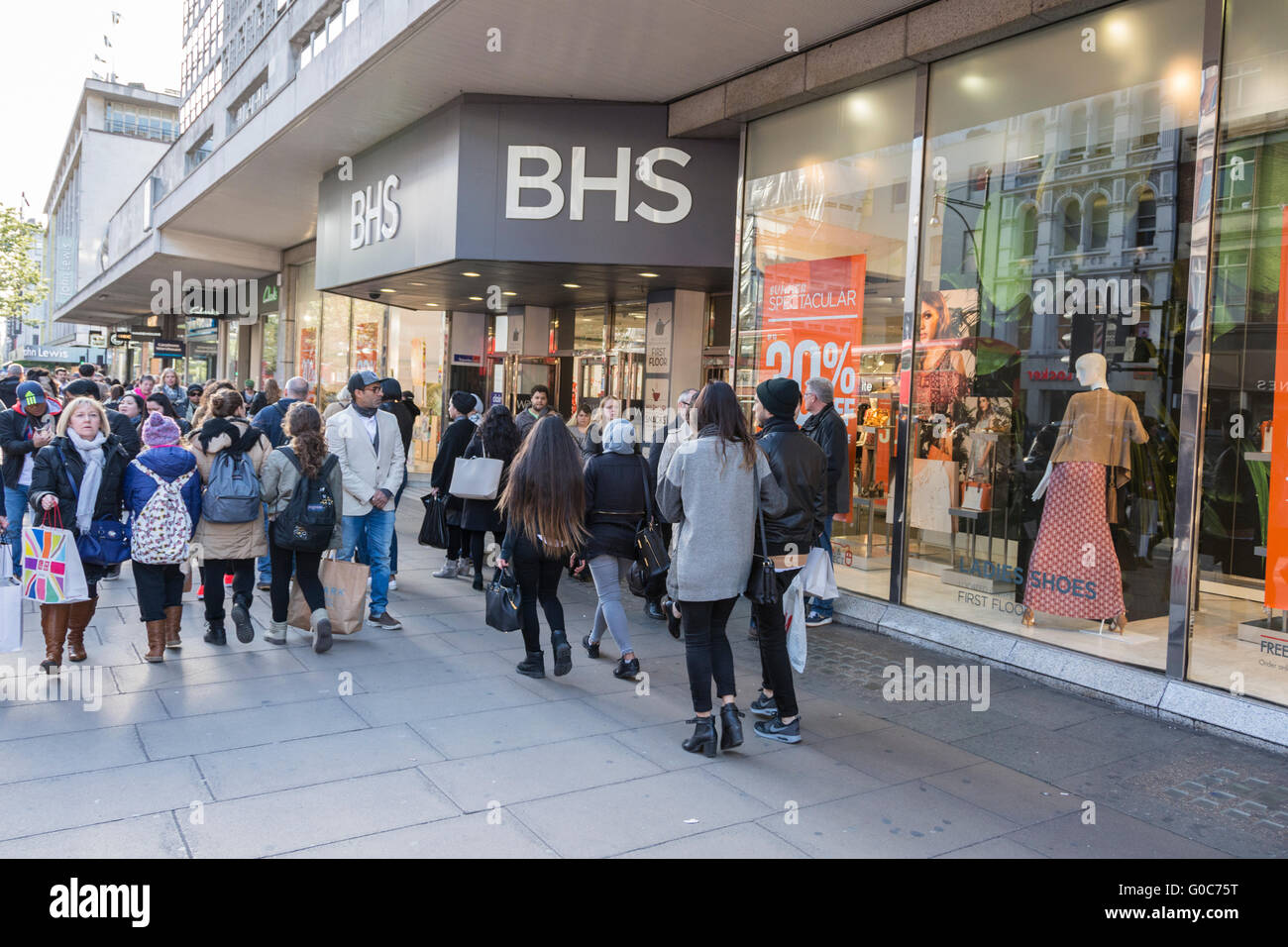 Shoppers pass in front of the former flagship BHS store on London's Oxford Street. - Stock Image