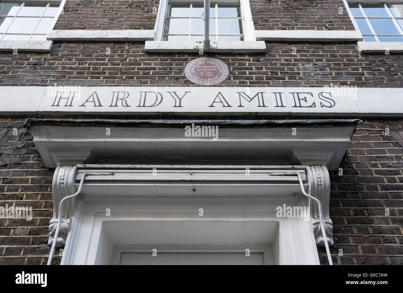 Plaque outside Hardy Amies, Bespoke Tailors in Saville Row, London, UK - Stock Image