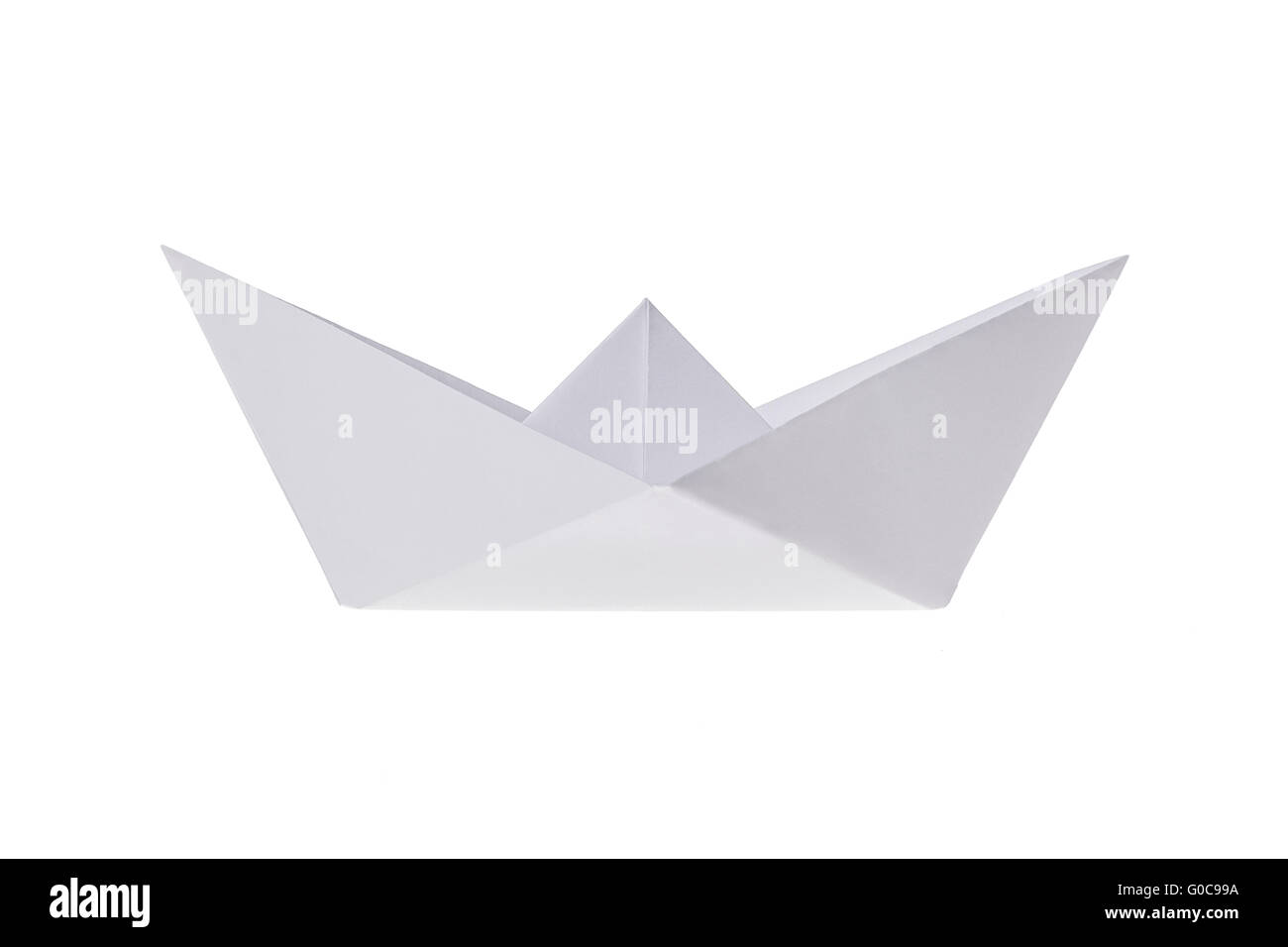 Folded ship, made out of paper on a white backgrou - Stock Image