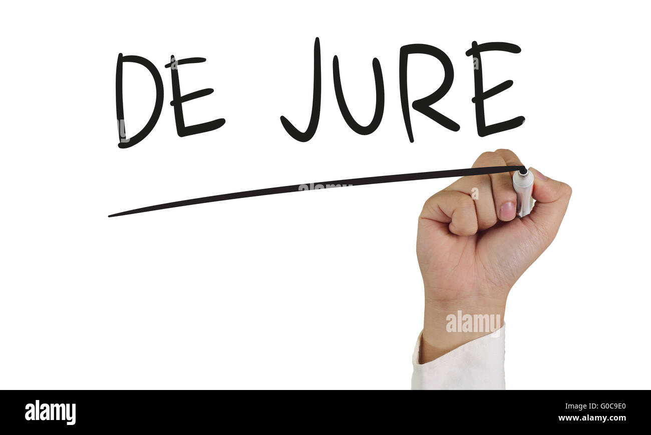 Business concept image of a hand holding marker and write De Jure isolated on white - Stock Image